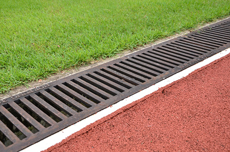All seasons news drainage systems to prevent water damage for Landscape channel drain